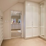 Dressing-Area<br /><p>Tailor-made cupboards designed to de-clutter a walk-through dressing area, enhancing the flow through to the en-suite.</p>